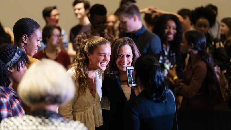 Senator Kamala Harris poses with a student