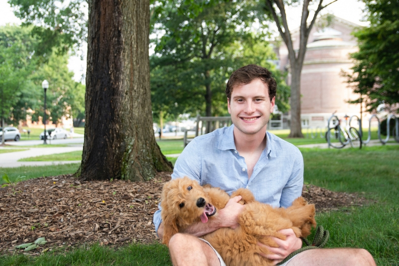 Blog author with Golden Doodle puppy in lap