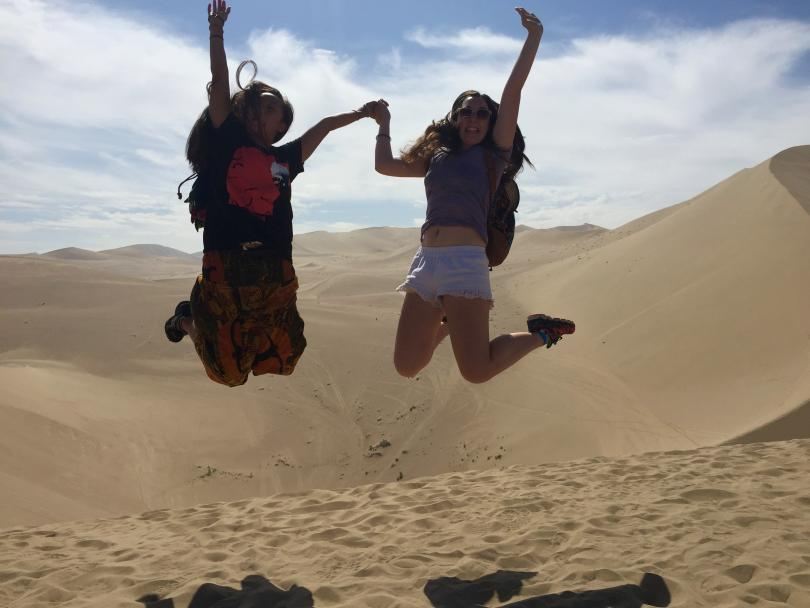 jumping for joy in the Gobi desert