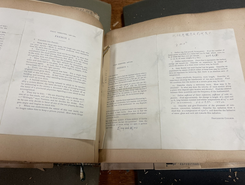an scrapbook showing old exam papers
