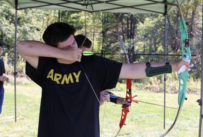 Gabe Gilbert shooting a bow