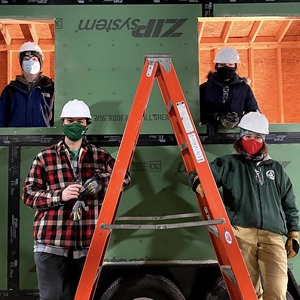 A photo of students working on an ultra-sustainable, tiny research station on wheels. The Tiny Team: Emma Doherty '21; Bradley Hart '21; Jack Lipson '21; Andrew Moura '21; Grace Neiswander '21; Soon-Young Shimizu '21