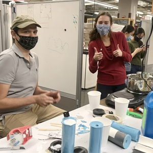 A photo of students at the Makers-At-Dartmouth (MAD) Lab at Thayer School