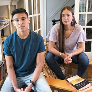 A photo of two students in the living space of the Native American house on campus