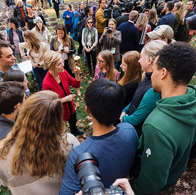 A photo of presidential candidate Elizabeth Warren visiting campus and talking with students