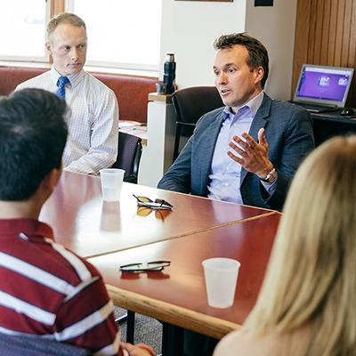 A photo of Secretary of the Army Eric Fanning '90 talking with a class