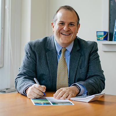 A photo of G. Dino Koff, Director of Financial Aid