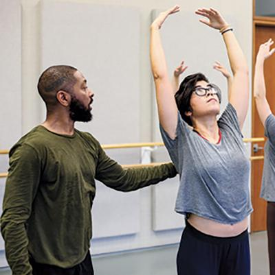 A photo of a student taking direction from Kyle Abraham during a masterclass