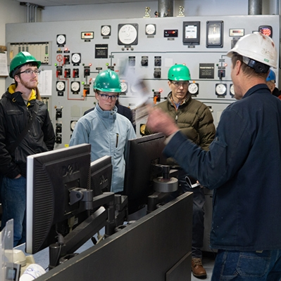 A photo of students touring the power plant faciliites