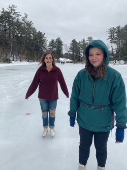 Abbi and a friend skating on Occom pond