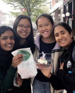 Me and my friends holding the desserts from Lou's.