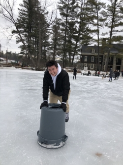 Gabe using a trash can to ice skate