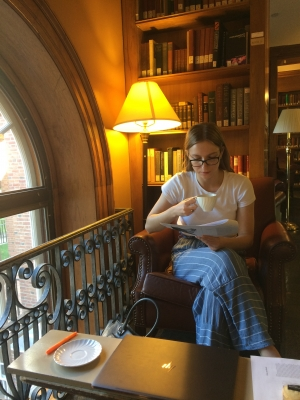 Isabel drinking tea in Sanborn Library