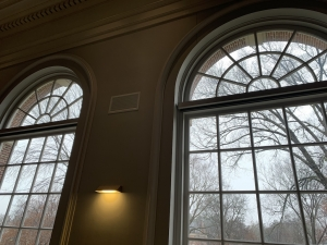huge windows looking into a grey outdoors