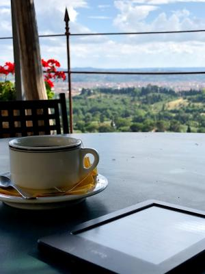 coffee cup and Kindle overlooking scenic Italian vista