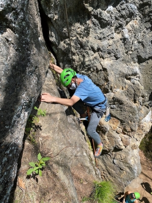 A picture of Owen at the crux of the climb.