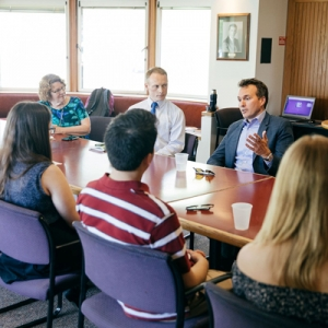 A photo of students speaking with 22nd Secretary of the Army, Eric Fanning '90