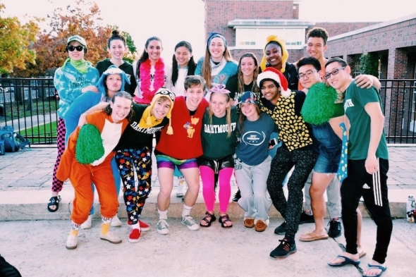 The club swim team outside at a meet dressed in flair!