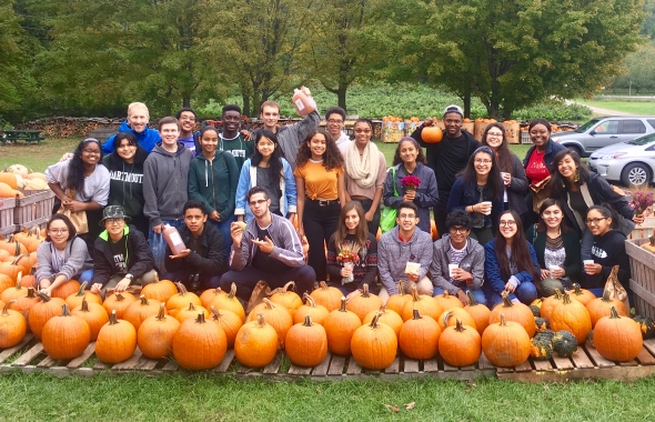 All smiles for FYSEP students after a successful apple-picking expedition!