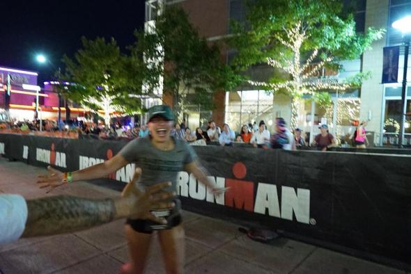 girl running through finish line