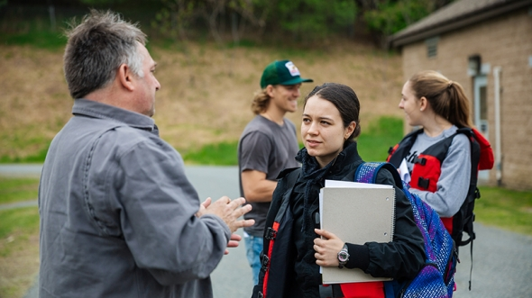Anthropology student Anela Arifi '20 talks with Kevin Maclean manager of the Hanover Wastewater Treatment Facility, during a stop on a class canoe trip on the Connecticut River.