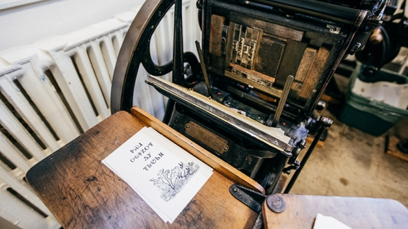 A vintage press in the Book Arts Workshop is used to create prints in the Cherokee language.