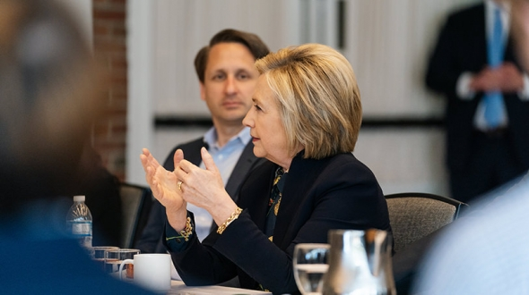 Hillary Rodham Clinton speaks with students in the Dickey Center's War and Peace Fellows program as program coordinator Benjamin Valentino listens.