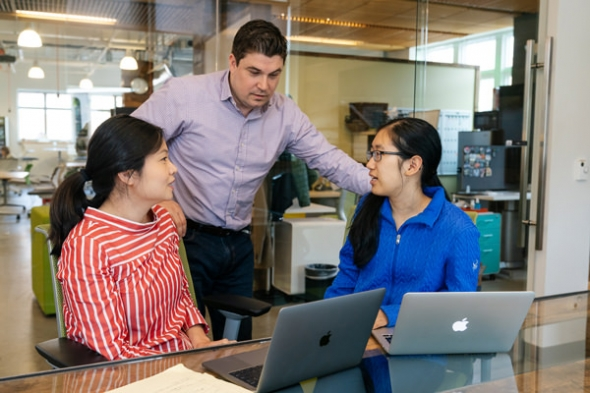 Jamie Coughlin, director of the Magnuson Center for Entrepreneurship, checks in with Annie Ren, program manager at the center and Sarah Hong '21, a student leader at Magnuson, as they discuss a public event about venture capital.