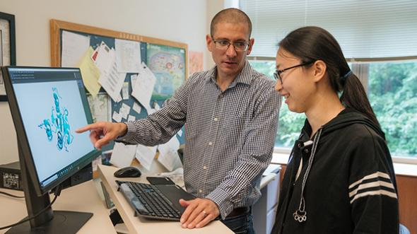 "Assistant Professor Michael Ragusa and graduate student ​Xue ""Sherry"" Xia"